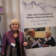 Speaking at the NATO High Level Conference on Women, Peace and Security, Sarajevo March 2019 in front of a poster featuring NATO Sir Stuart Peach and myself